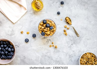 Oat flakes with honey and berries on table background top view