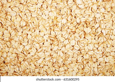 Oat flakes on a light wooden background