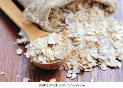 Oat flakes on wooden table