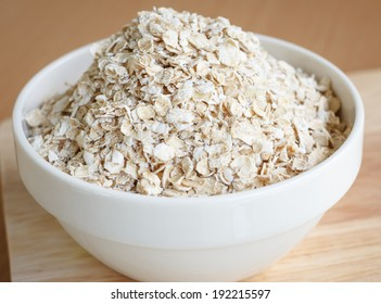 Oat flakes pile in cup