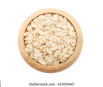 Oat flakes pile in wooden dish isolated on white background, Save clipping path.