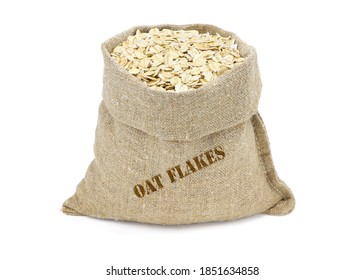 Oat flakes in a sack isolated on a white background. Oat flakes in burlap sack. Oat flakes in jute bag. Healthy food.