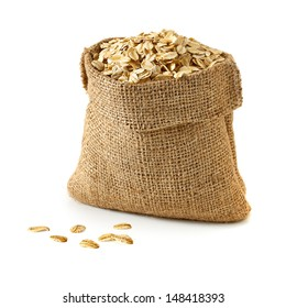 Oat flakes in sack on white background