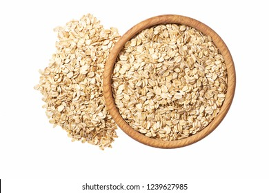 Oat flakes uncooked  in  wooden  bowl on white background concept of healthy eating vegan food