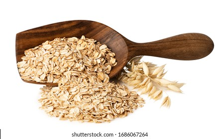 oat flakes in wooden scoop and ripe ears isolated on white background