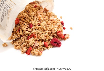 Oat Granola with dried raspberries breakfast cereal from the packaging isolated on white background