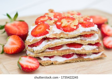 Oat pancake cake filled with cottage cheese and strawberries