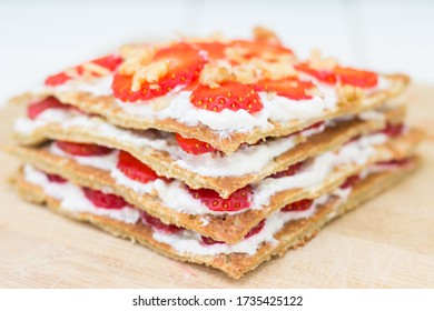Oat pancake cake filled with cottage cheese and fresh strawberries