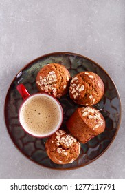Oat and raspberry muffins and cup of coffee