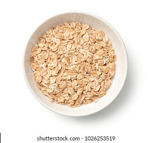 Oat rye flakes in bowl isolated on white background. Top view