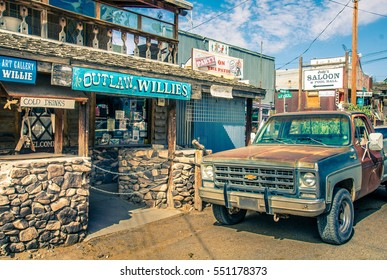 OATMAN, Arizona - September 10, 2015: Modern Wild West scenery with tourist shops and old rusty pickup car in Oatman. Made during a motorcycle road trip through the united states - Vintage Color Look