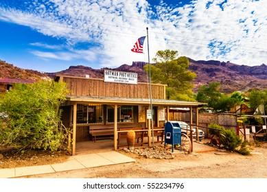 OATMAN, Arizona - September 10, 2015: Historic US Post Office in Oatman, Arizona. The colorful picture shows the post office located at famous Highway Route 66 in front of the black mountains.