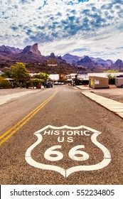 OATMAN, Arizona - September 10, 2015: Historic US Route 66 with highway sign on asphalt and a panoramic view of Oatman, Arizona. Picture made during motorcycle road trip through western states of USA.