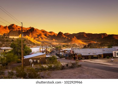 Oatman, Arizona, USA - December 28, 2017 : Sunset in Oatman on the historic Route 66. This former mining town is situated in the Black Mountains of Mohave County in Arizona.