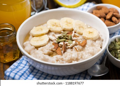 oatmeal with banana, honey and nuts, closeup