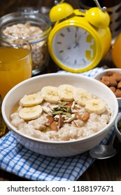 oatmeal with banana, honey and nuts, vertical closeup