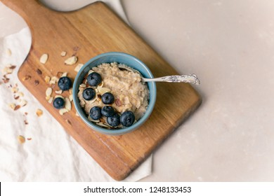 Oatmeal in a Blue Bowl with Blueberries and Toasted Almonds