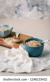 Oatmeal with Brown Sugar; Rolled and Steel-Cut Oats in Background