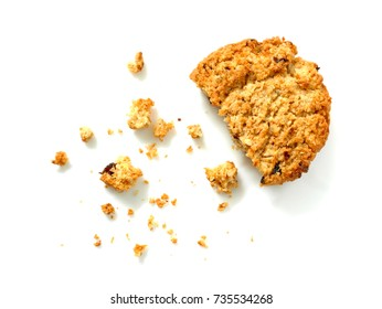 Oatmeal cookie with crumbs isolated on white background. Top view.