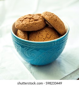 Oatmeal cookies in a blue bowl