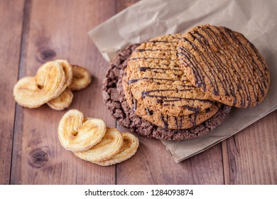 oatmeal cookies with chocolate on a brown paper and sweet cookies in the shape of a heart