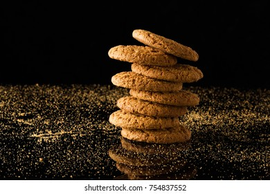 Oatmeal cookies with crumbs, isolated on a black background.