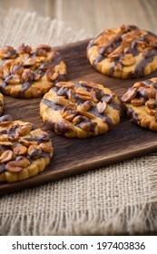 Oatmeal cookies with hazelnuts and chocolate. Studio photography.