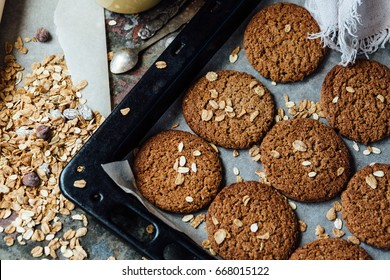 Oatmeal cookies and ingredients and coffee on  table in rustic style