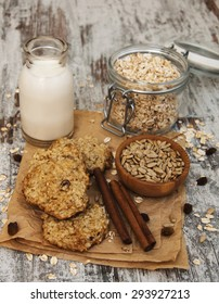 Oatmeal cookies with milk on a old wooden table