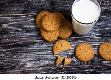 Oatmeal cookies with milk on a wooden table in rustic style
