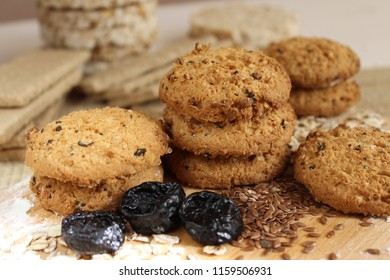 Oatmeal cookies with prunes and flax on a wooden background