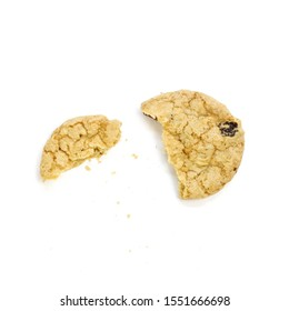 Oatmeal cookies with raisins. Broken in half cookies. Top view. Close up. Isolated on white background.