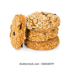 Oatmeal cookies with raisins and sesame seeds isolated on white background
