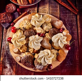 Oatmeal cookies and sand chocolate cake with cherry berry and crispy wafer rolls with cream on cutting board on wooden table in rustic style. Limitations for diabetics. Grandma's recipes.
