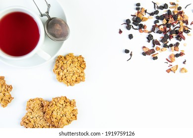Oatmeal cookies, with seeds, fruit tea in a cup on a white background, top view, isolated