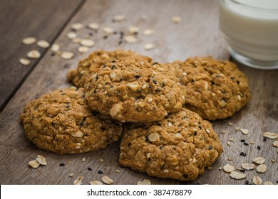 Oatmeal cookies with sesame seeds and glass of milk