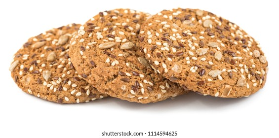 Oatmeal cookies sprinkled with sunflower seeds, linseed and sesame seeds. Healthy pastries isolated on a white background