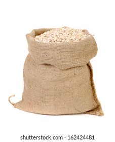 Oatmeal flakes in sack. Isolated on a white background.