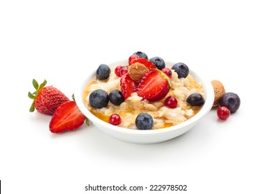 Oatmeal  and fresh fruits isolated on white background.