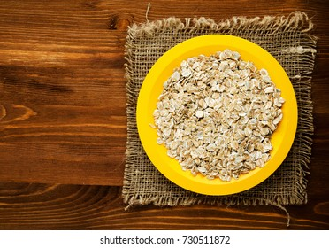 Oatmeal on a wooden . Oatmeal top view.