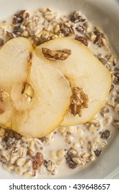 Oatmeal with pear and walnuts in the bowl