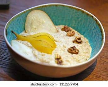 Oatmeal with pear and walnuts on almond a milk