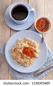 Oatmeal porridge with cloudberry jam