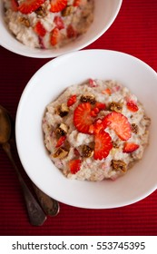 Oatmeal porridge with fresh strawberries and figs