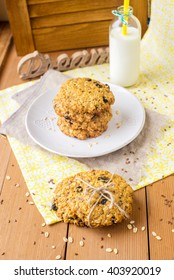 Oatmeal raisin cookie tower  with flax and sesame seeds and  bottle of milk on the background