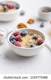 Oatmeal served with frozen berries and superfood seeds