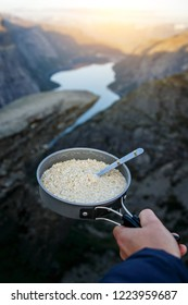Oatmeal in a skillet. Breakfast on trolltunga, troll tongue, the most famous showplace in Norway
