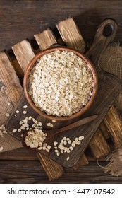 Oatmeal in a wooden bowl on a wooden table