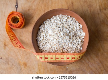Oats in the bowl on table