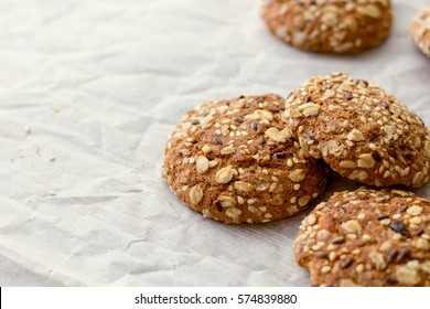 Oats cookies on a gray table in rustic style. seeds on baking.  front horizontal view